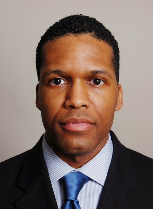 headshot of a black actor in washington dc wearing a suit and tie