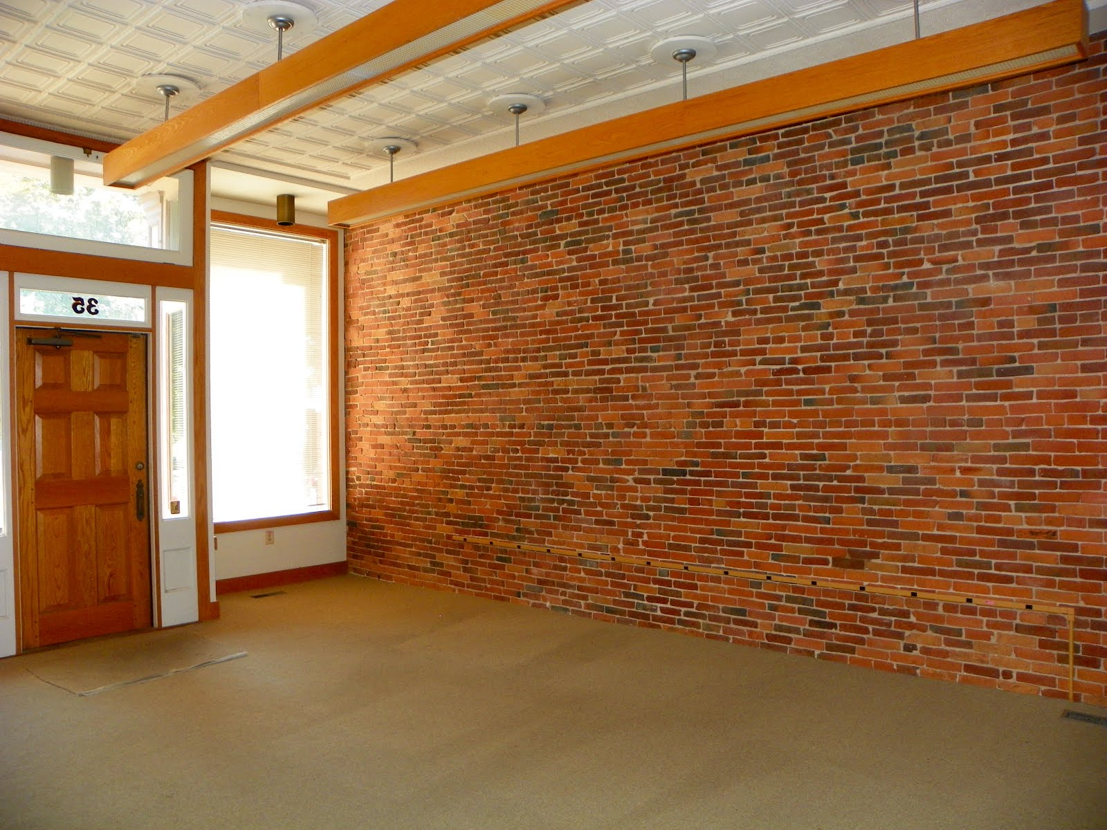 Only in the republic of amherst and another one gone for Brick wallpaper office