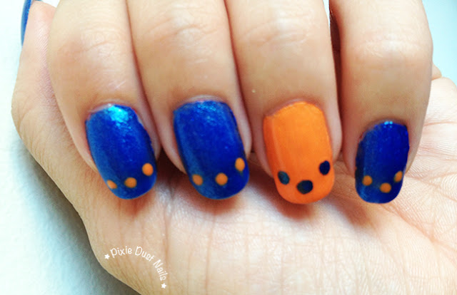 Blue and Orange nails with polka dots