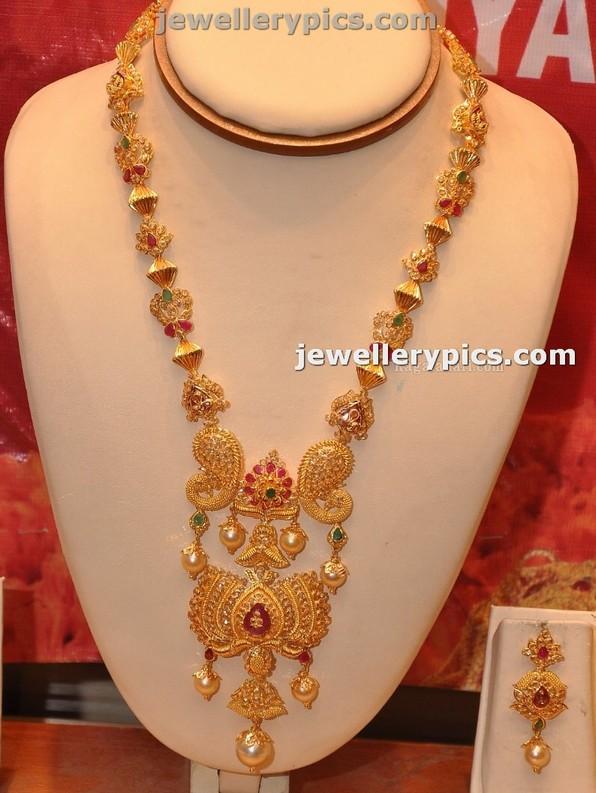 Diamond necklace set by khazana jewellers latest jewellery designs - Beutiful Gold Lotus Haram By Manepalli Jewellers Latest