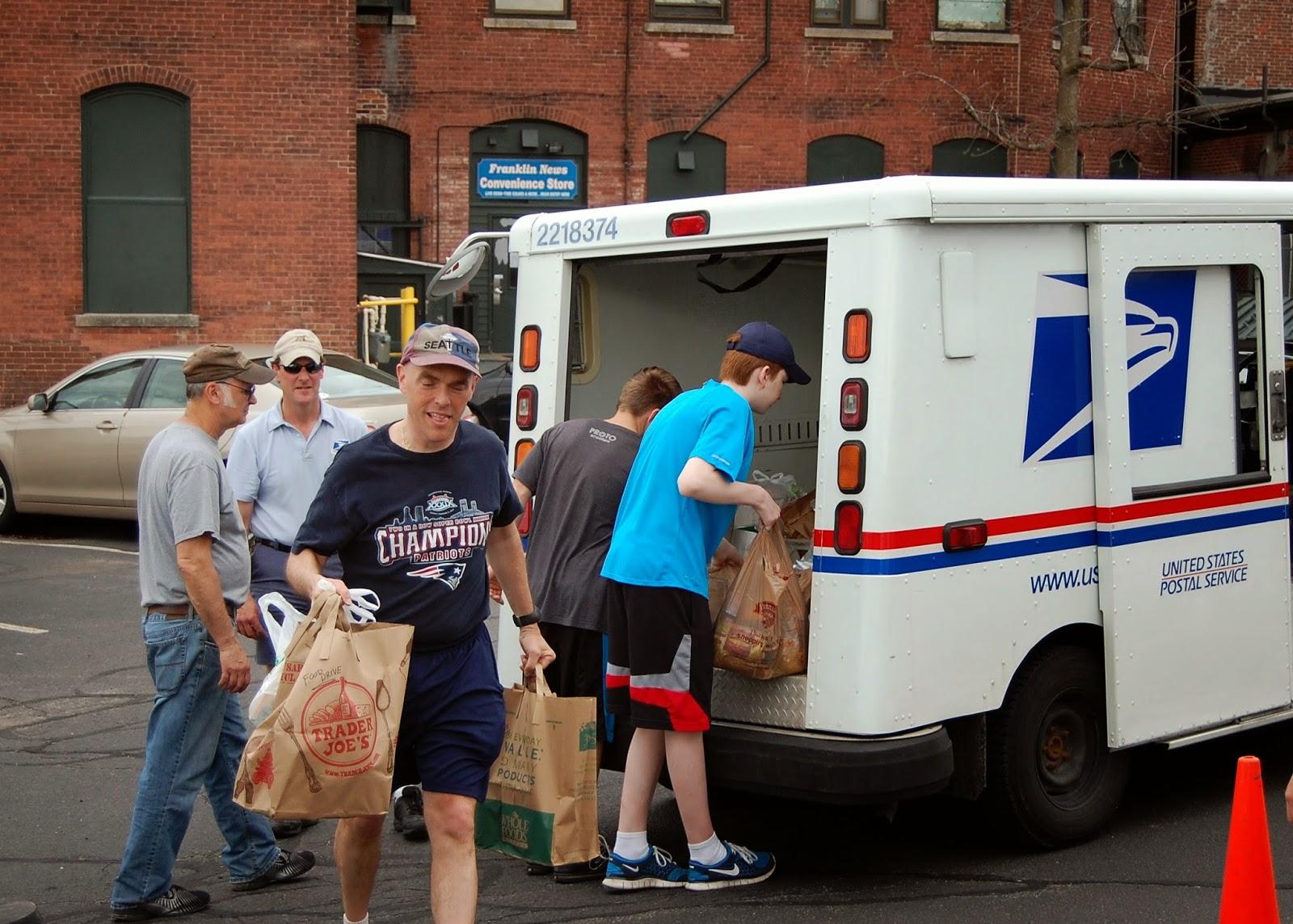 volunteers unloading the truck