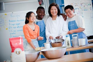 Three students and a teacher in a cooking class