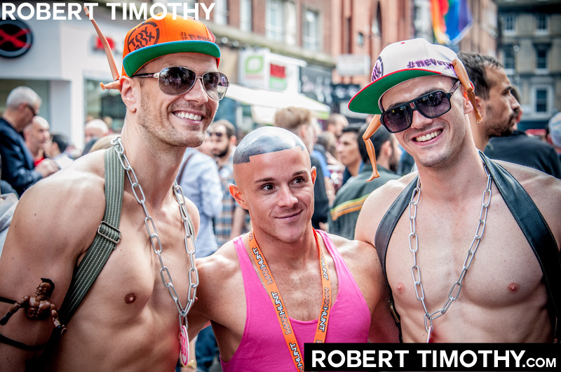 Three guys on Old Compton Street in London during 2012 World Gay Pride celebrations