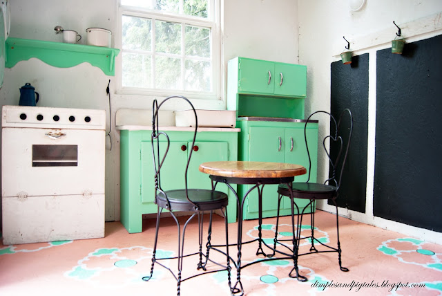 Child sized cabinets in mint green + vintage cafe chairs and table + chalkboard wall