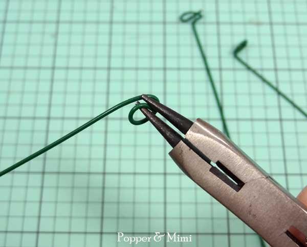 Bend floral wire to make paper flower stems   popperandmimi.com