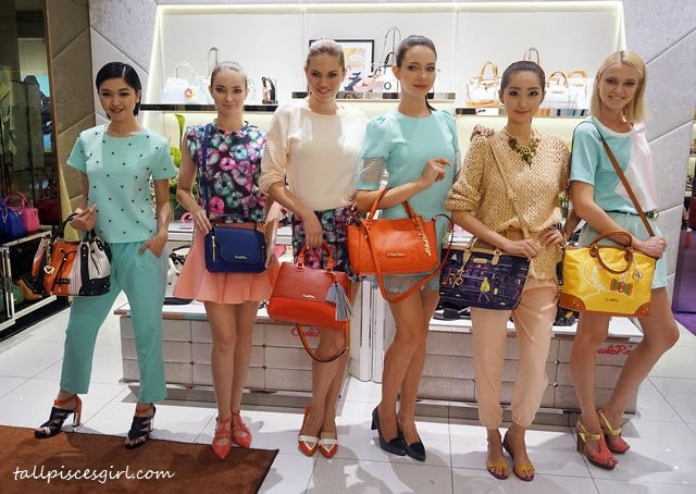 Models showcasing Carlo Rino latest bags and shoes from Spring Breeze 2015 Collection