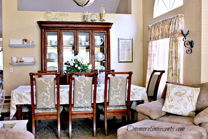 Balancing the dining room with assures and painted picture frame at One More Time Events.com