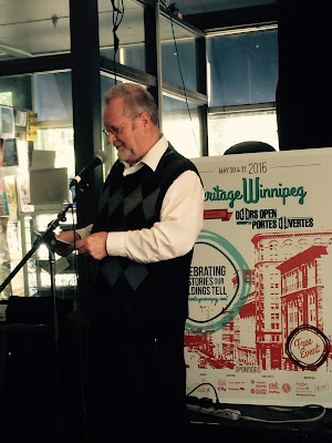 Heritage Winnipeg Board Member, Greg Agnew, gives a short history of the building before presenting the award.