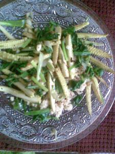 greeny babycorn on a bed of daliya/couscous