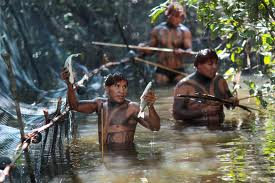 Tribal searching fishes in amazon river forest