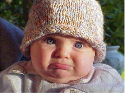 Photo bébé mimi pas content