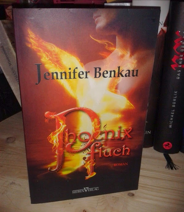 http://www.amazon.de/Phoenixfluch-Jennifer-Benkau/dp/3941547119/ref=sr_1_1?s=books&ie=UTF8&qid=1396012770&sr=1-1&keywords=Ph%C3%B6nixfluch