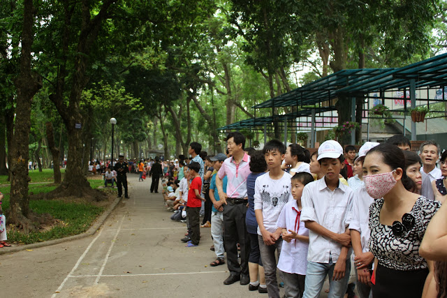 We were waiting in the long queues at Botanical Garden before heading to Ho Chi Minh Mausoleum during Reunification Day in Hanoi, Vietnam