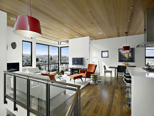Warm modern living room on third floor with wooden ceiling