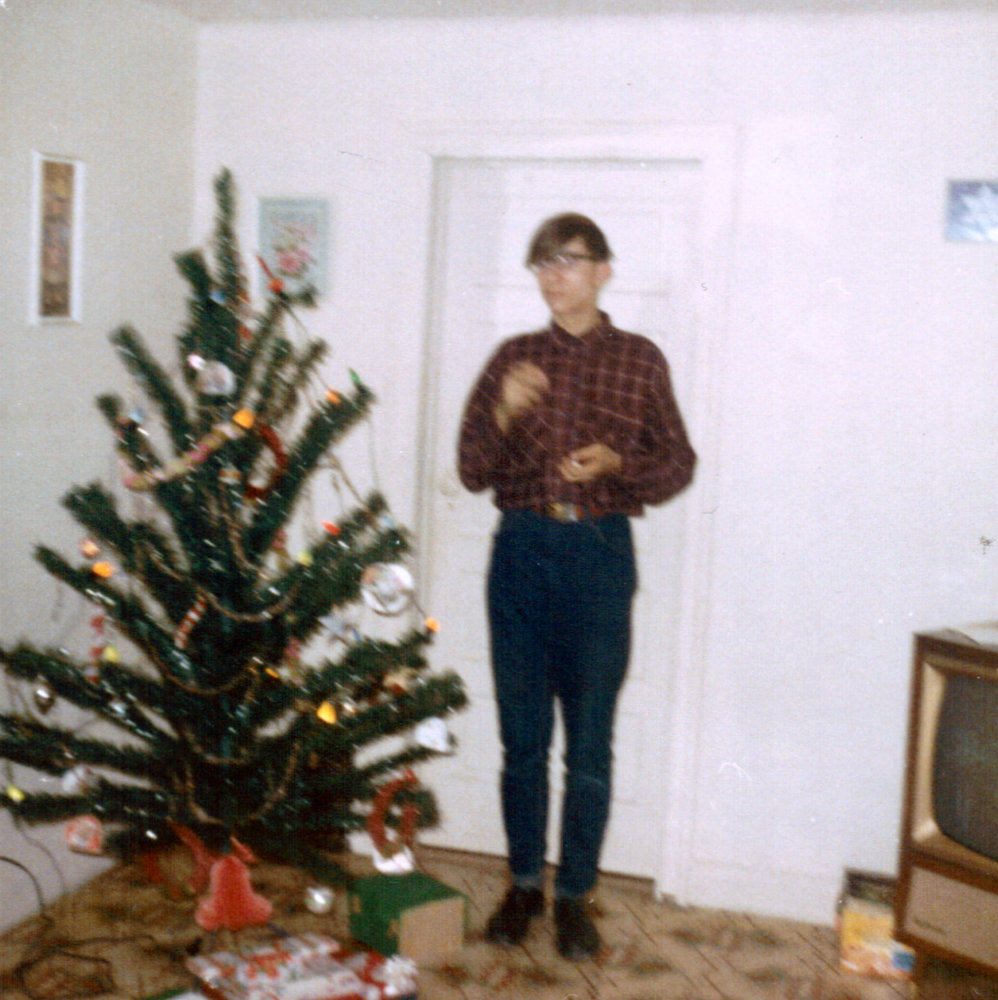 Michael decorating the Christmas tree about 1967