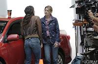 Sandra Oh and Ellen Pompeo film a scene on the set of Grey's Anatomy