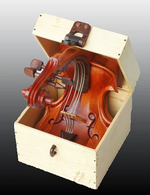 03-Back-in-Tune-Philippe-Guillerm-Musical-Instruments-Sculptures-French-Artist-Musician-Sculptor-Painter-Furniture-Maker-www-designstack-co