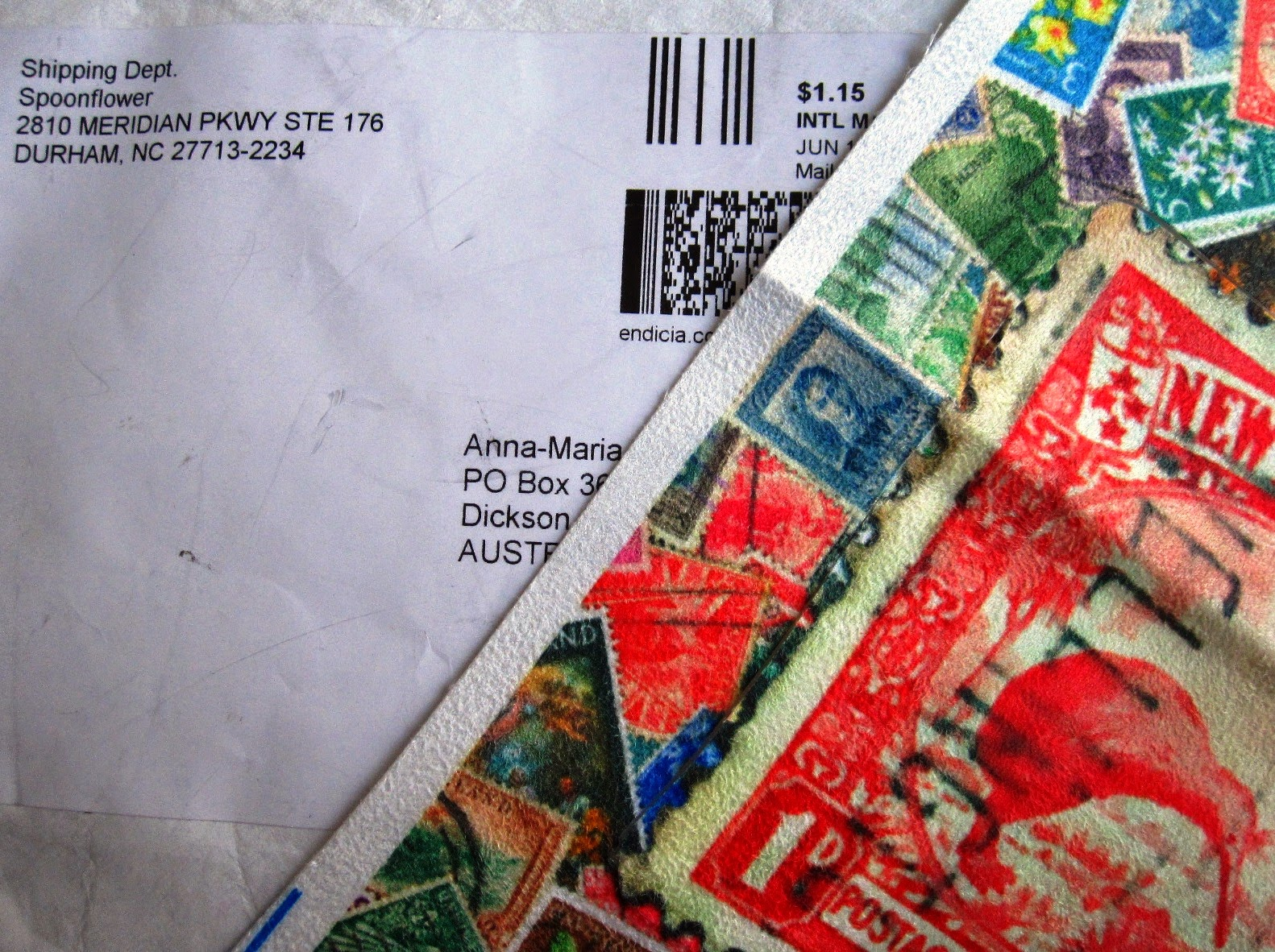 Mailing envelope from fabric-printing company Spoonflower with a sample of their faux suede fabric printed with New Zealand stamps.