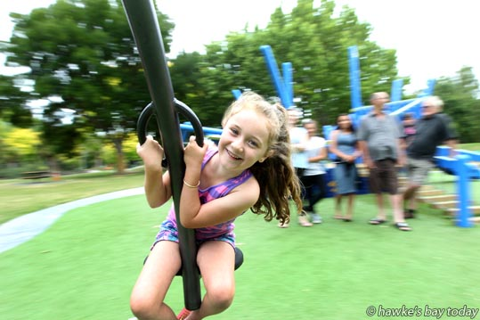 Sophie Munroe, 7, Hastings, playing at the new Lions Community Playground, corner Grove Rd and Sylvan Rd, Hastings, in the  warm, cloudy weather. photograph