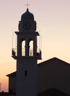 Greek Church at sunset. Travel novels - inspiring fiction stories set in strange countries