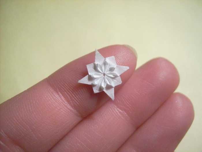 Miniature origami sculptures spicytec german artist anja markiewicz creates miniature sculptures out of paper extremely tiny origami creations look like different animals and flowers mightylinksfo
