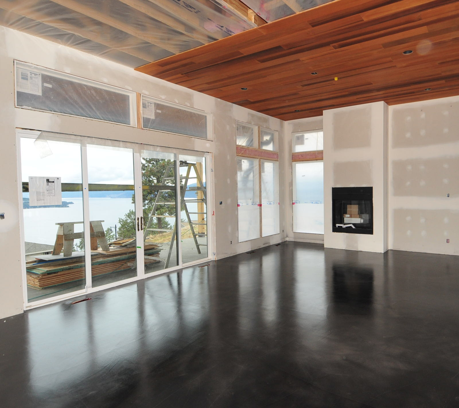 Mode concrete black acid stained modern concrete floor for Wood floor and ceiling