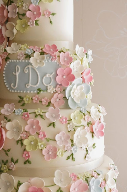 pastel wedding cake with fondant flowers