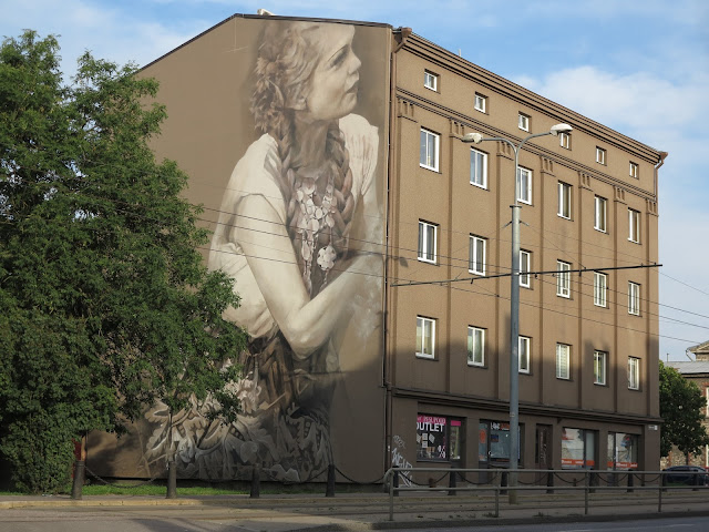 Guido Van Helten is currently in Eastern Europe where he just finished working on a brand new piece somewhere on the streets of Tallinn in Estonia.