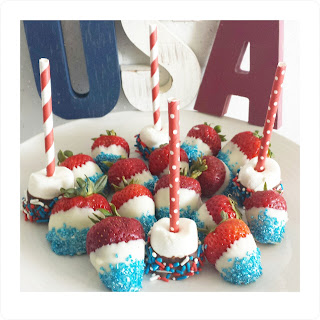red white and blue dipped marshmallow and strawberries