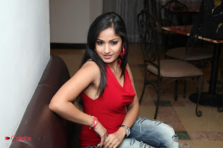 Madhavi Latha  Pictures in Red Sleeveless Top and Jeans at Muse Art Gallery  0019.jpg