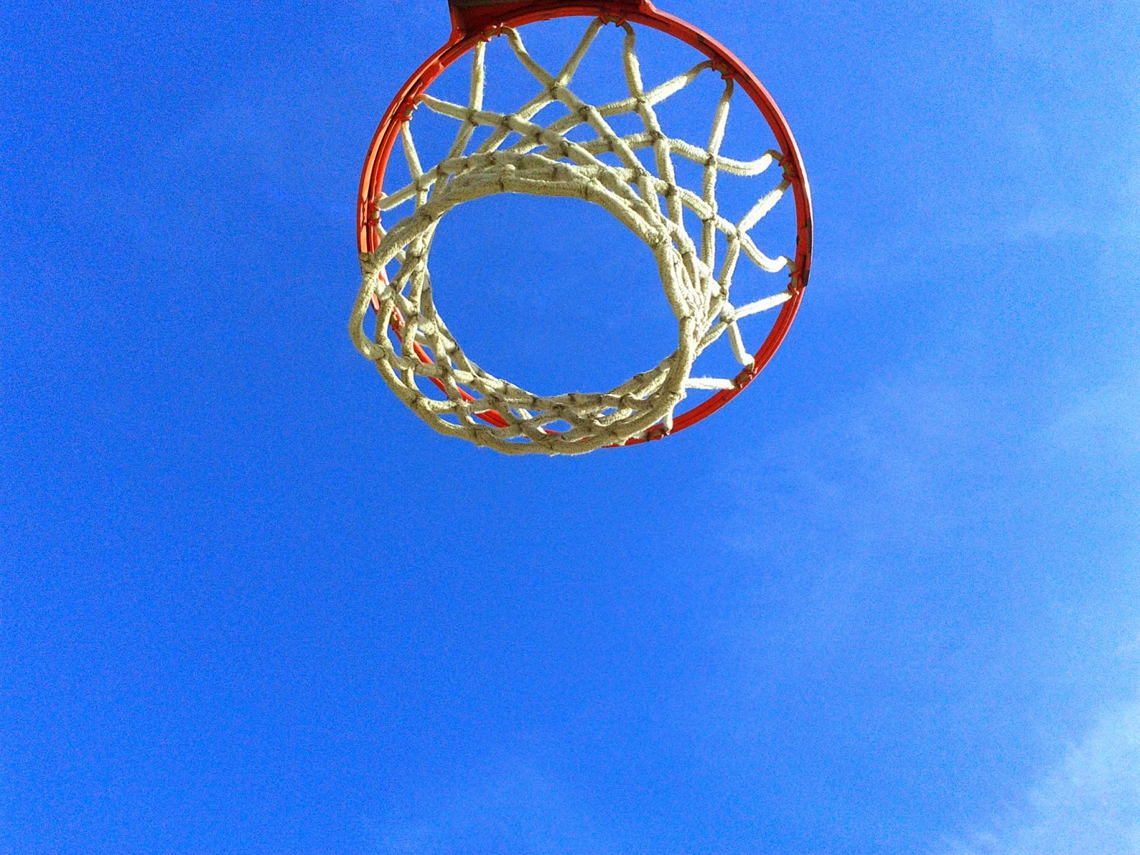 Stock Photo: Basketball rim / net with blue sky in background