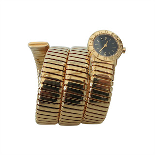 Vintage 1980's gold Bulgari snake watch with black face and wrap around design.