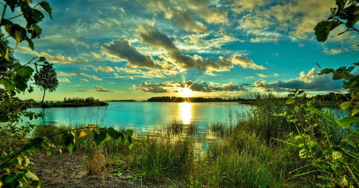 Hermoso paisaje de un lago al amanecer | Foto Frontera