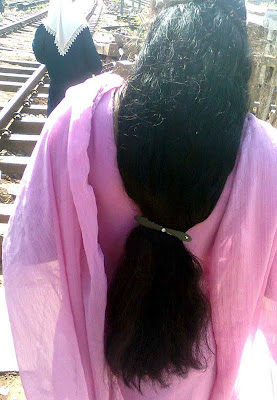 Kerala aunt with voluminous and thick long hair.