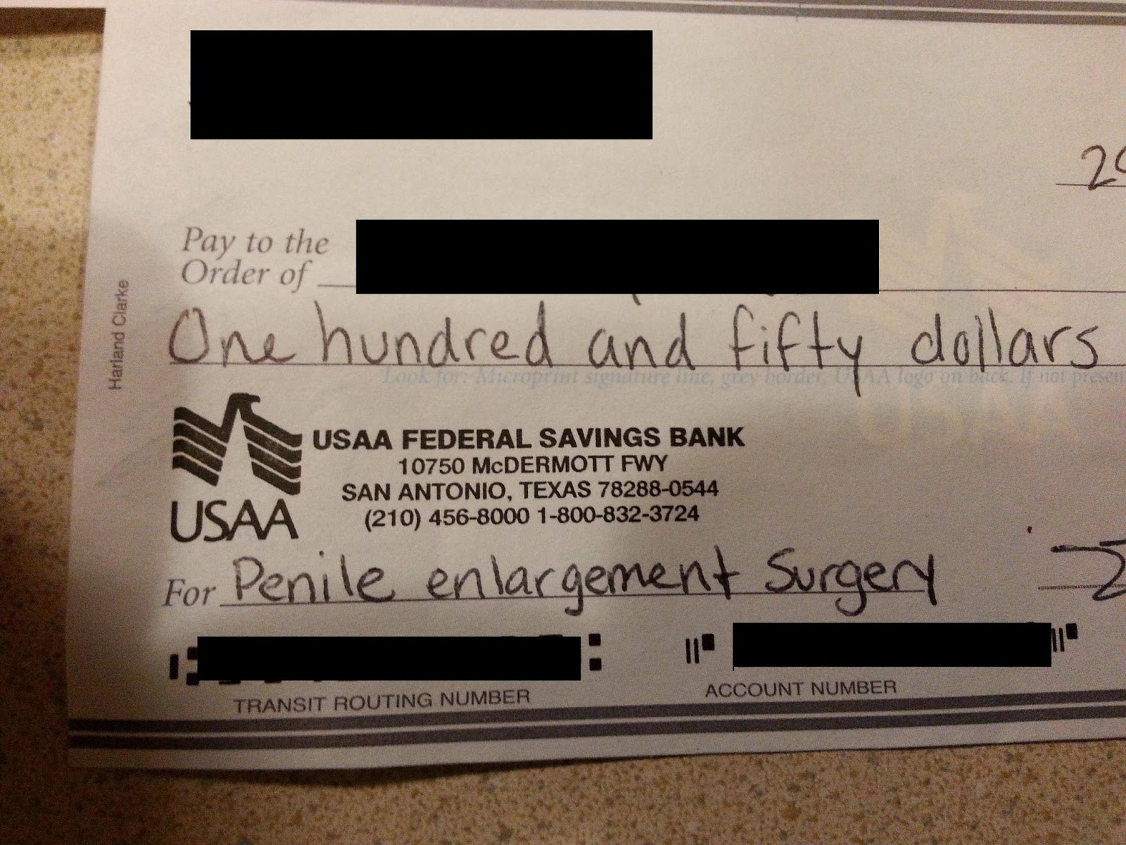 Writing Out A Cheque $150 For Penile Enlargement Surgery