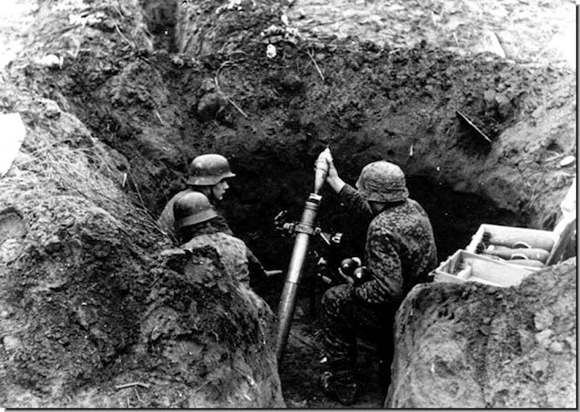 Waffen SS troops fire mortar in Budapest. 1944.