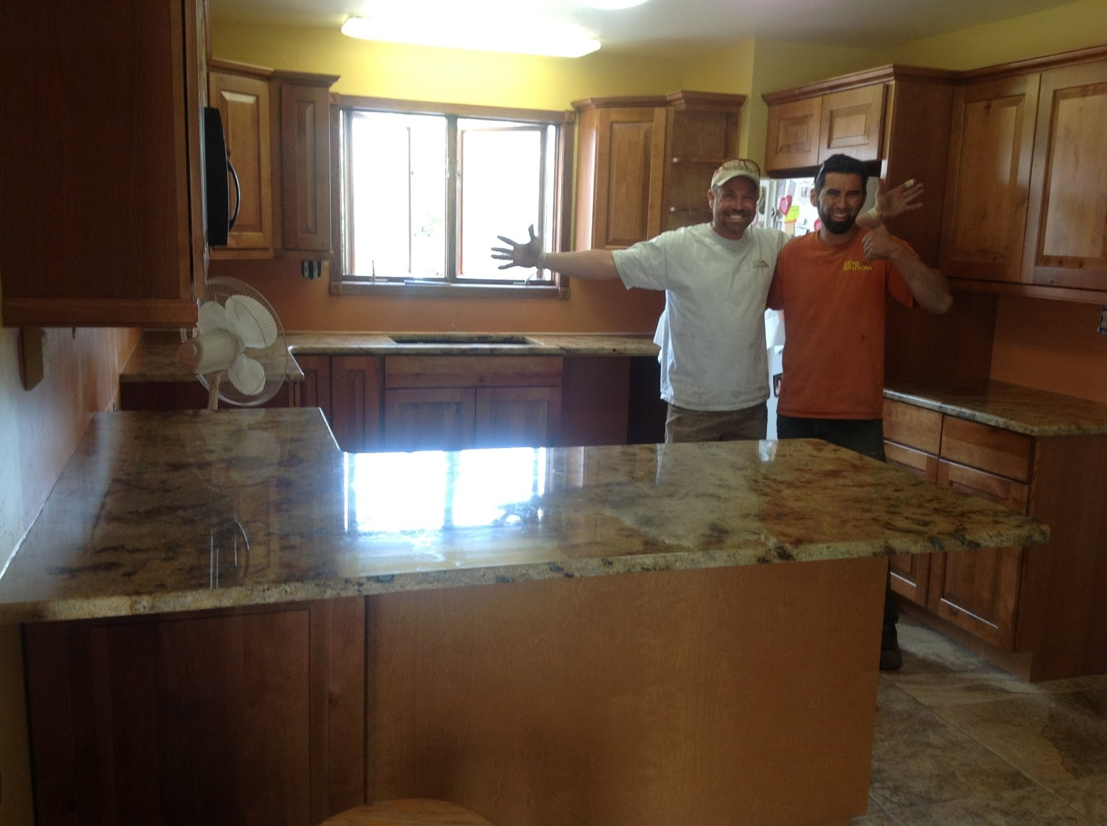 Lapidus Granite with Oak Cabinets