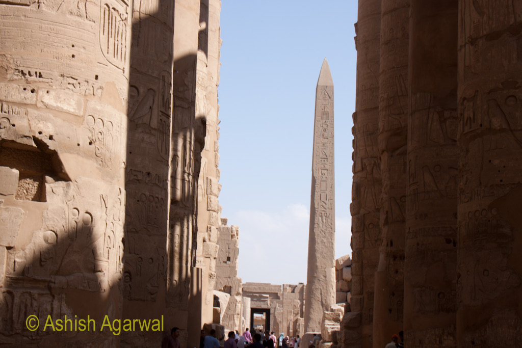 View of the Obelisk, as seen from the rows of pillars inside the Hypostyle Hall in the Karnak temple