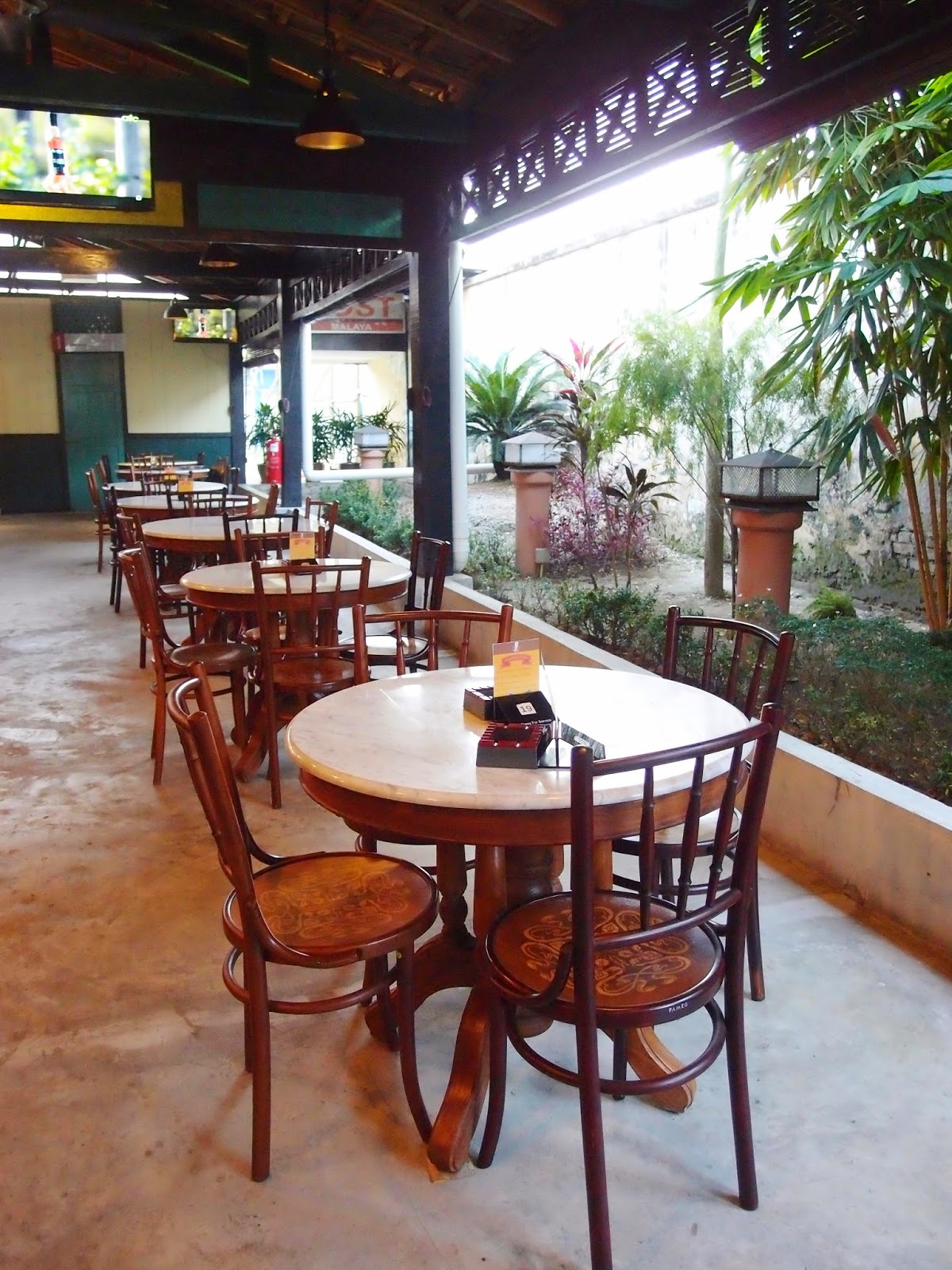 Marble Top Dining Tables With Old School Kopitiam Chairs Complete The Decor For This Charming Place