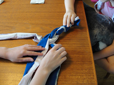 child braiding t-shirt strips