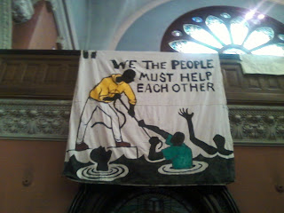 Signs and literature on mutual aid at 520 Clinton Ave. 