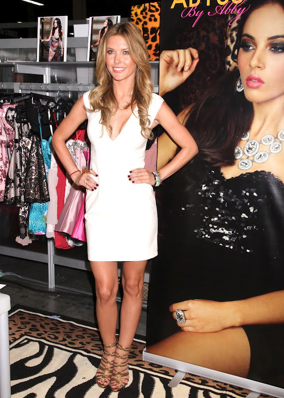 Audrina Patridge posing in a white dress