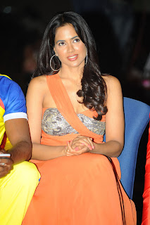 Sameera Reddy in sizzling Orange Saree and Strapless Blouse at CCL Event