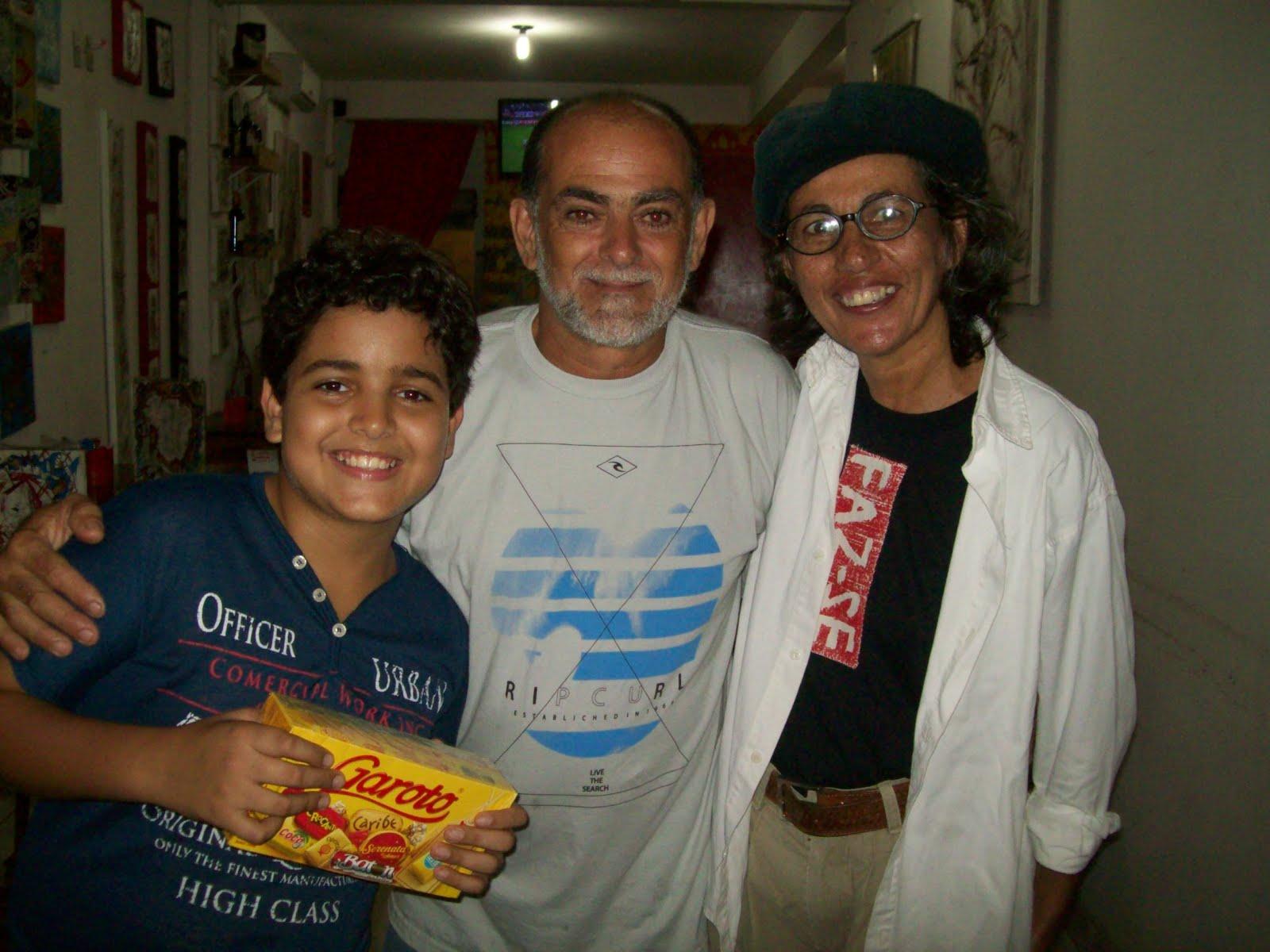 Guilherme, 13 anos e seu pai. Ouvintes-leitores Alacazum