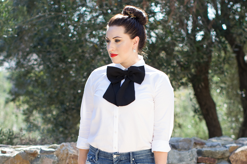 oversized bow tie, white button up, red lipstick
