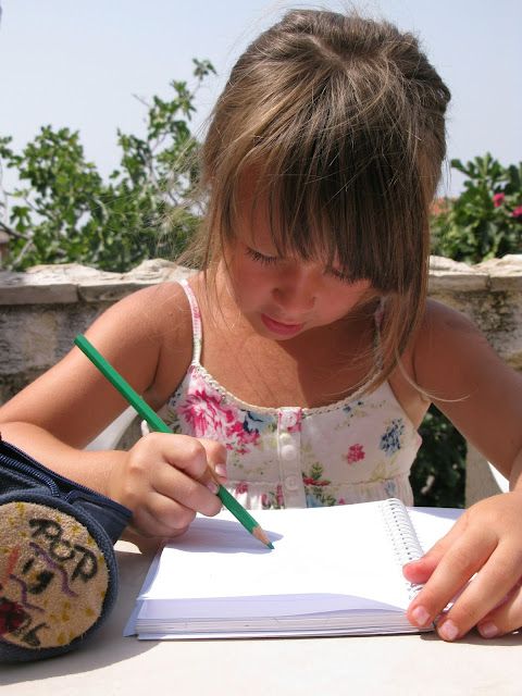 NAMC should we still teach handwriting in the Montessori classroom girl writing