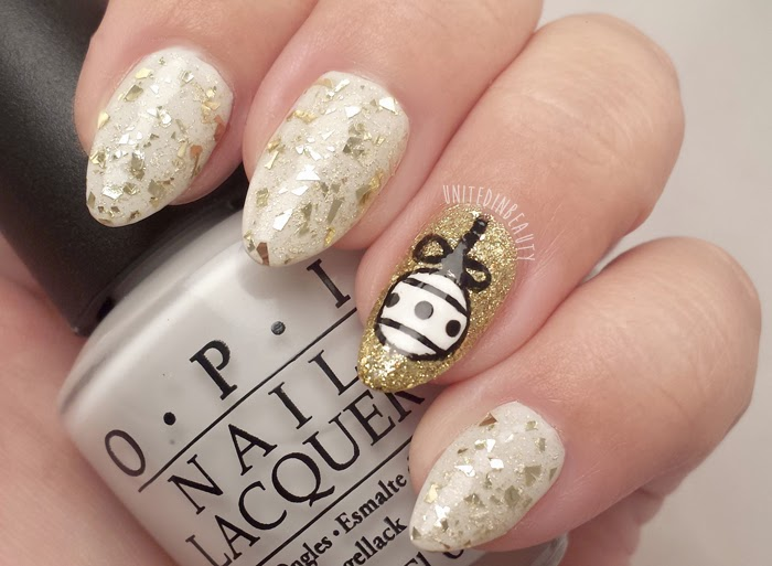 White & Gold Nails with Handpainted Ornament by @unitedinbeauty