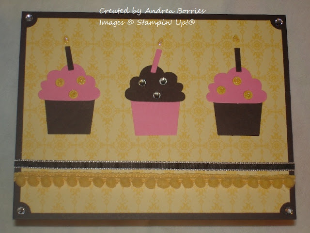 Birthday card with yellow background and three pink and brown cupcakes.