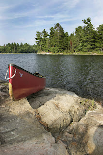 Image of a canoe on a lake