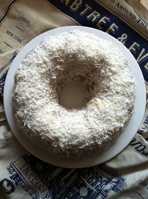 Southern Spoon blog: triple berry buttermilk bundt cake topped with lemon glaze and coconut